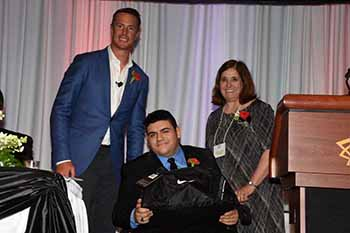 NFL MVP Matt Ryan, Honorary Chair Nico Santiago, and Club VP Debbie Salmon